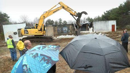 As a steady rain fell, Brookhaven Town officials