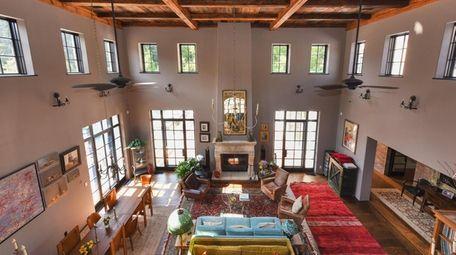 Repurposed wood adorns the soaring 20-foot ceiling in
