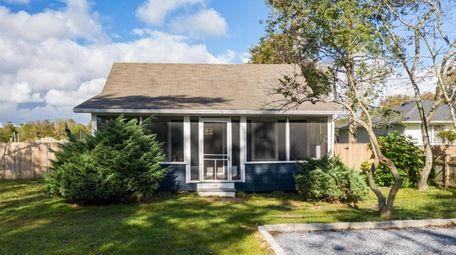 The agent calls it a quaint summer cottage.
