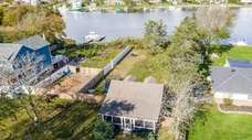 The 0.31-acre property has a large deck in