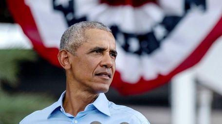 Former President Barack Obama speaks at a drive-in