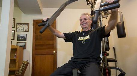 Stephen Virgilio, seen exercising in his basement gym