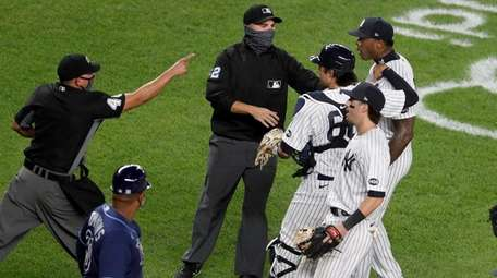 Aroldis Chapman of the Yankees is restrained as