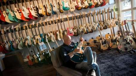 David Davidson, seated, owns Well Strung Guitars in