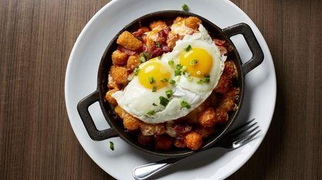 Breakfast poutine with crispy regular and sweet potato