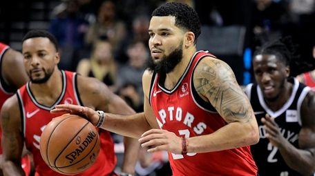 Fred VanVleet of the Toronto Raptors handles the