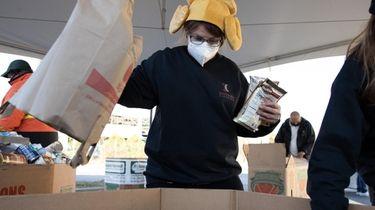 Melissa Vell, a volunteer, loads a bin Friday