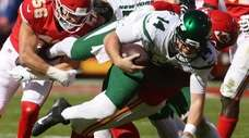 Sam Darnold of the Jets is sacked by