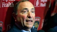 National Hockey League Commissioner Gary Bettman speaks to