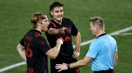 Red Bulls' Tim Parker, left, and Aaron Long