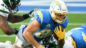 Hunter Henry of the Chargers is tackled by
