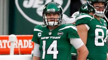 Sam Darnold of the Jets walks on the