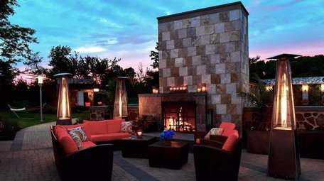 An outdoor fireplace is available to use for
