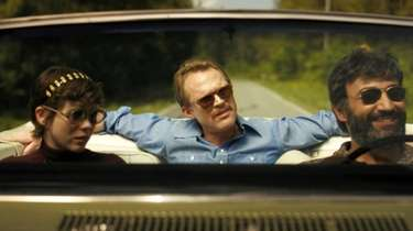 (L-R) Sophia Lillis,Paul Bettany and Peter Macdissi in