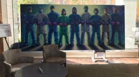 A mural of masked health care workers at