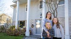 Karen Modlin with daughters Sarah,9, left, and Emily,