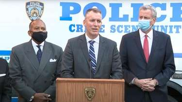NYPD Police Commissioner Dermot Shea, center and Mayor