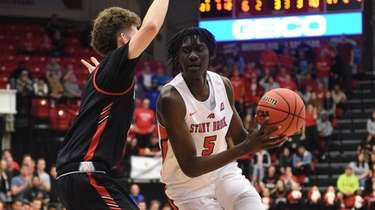 Stony Brook forward Mouhamadou Gueye drives the ball