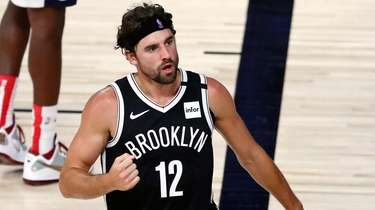 Nets forward Joe Harris reacts after a play