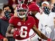 Alabama wide receiver DeVonta Smith (6) heads for