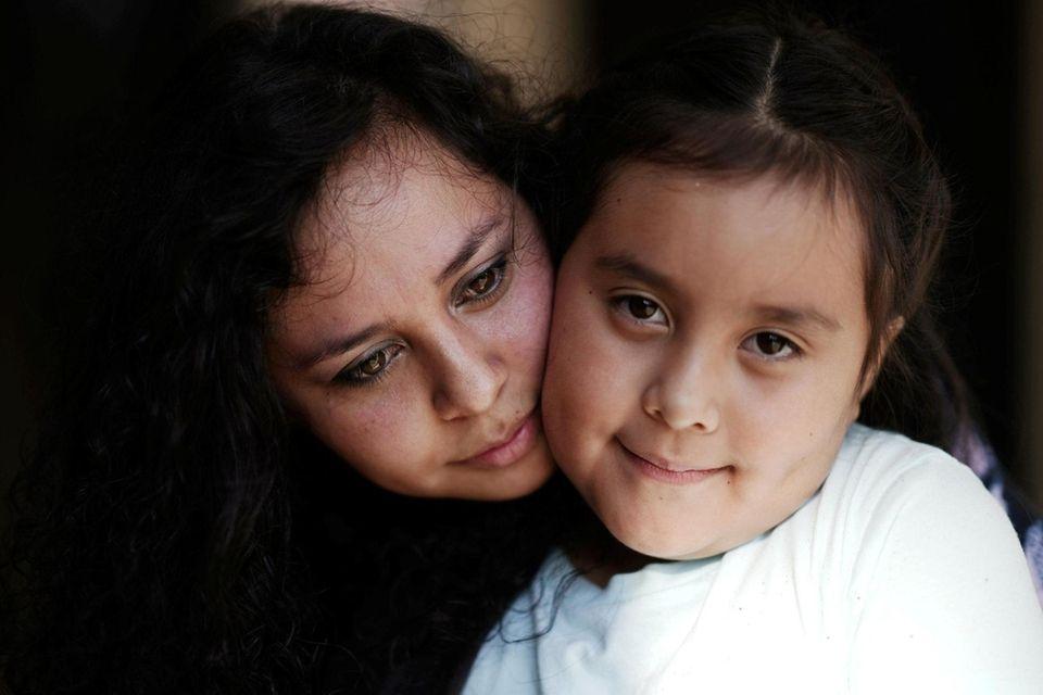 Jessica Arizaga, left, a new immigrant who wrote