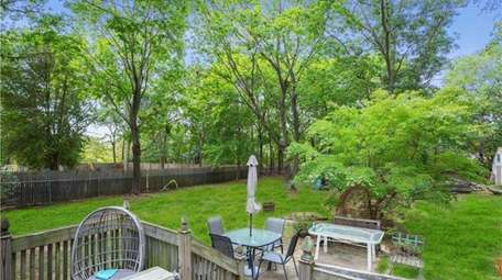 The property has a large deck, patio and