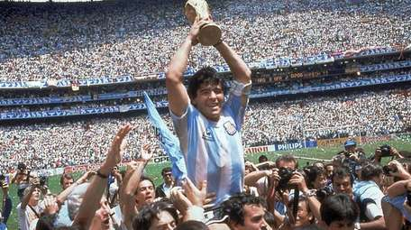 Diego Maradona of Argentina celebrates at the end