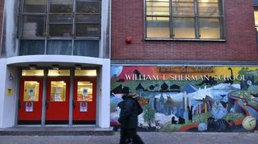People walk past William T. Sherman School PS