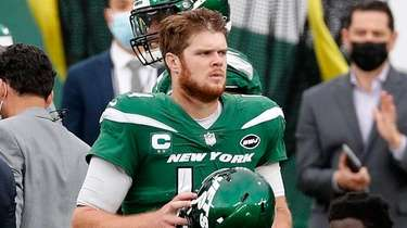 Sam Darnold of the Jets looks on from