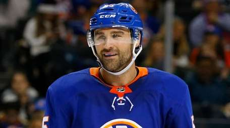 Johnny Boychuk #55 of the Islanders looks on