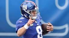 Daniel Jones #8 of the Giants reacts as