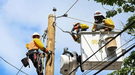 Workers contracted by PSEG  work on restoring