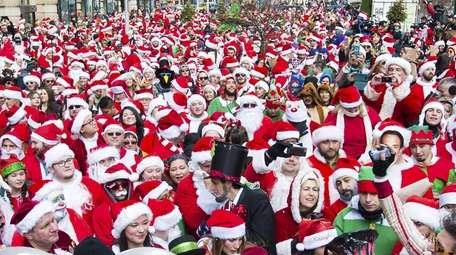 Pre-pandemic SantaCon revelers are seen in Manhattan, long
