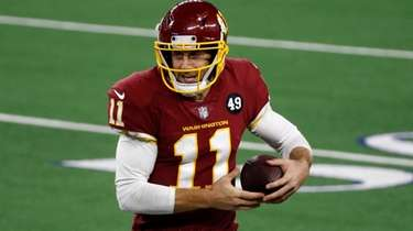 Washington Football Team quarterback Alex Smith runs the