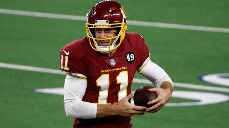 Washington Football Team quarterback Alex Smith runs the