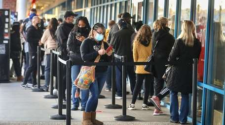 Black Friday shoppers lined up outside the Michael