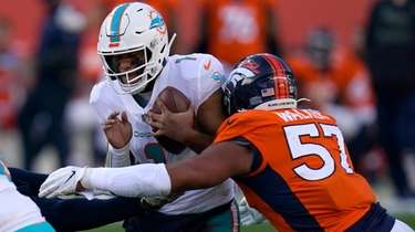 Miami Dolphins quarterback Tua Tagovailoa is sacked by