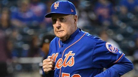 New York Mets pitching coach Phil Regan runs