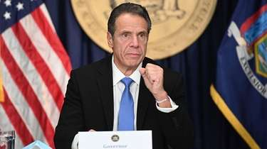New York Gov. Andrew M. Cuomo holds his