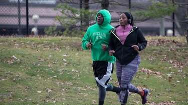 Rich and Charmaine McClain run along the path