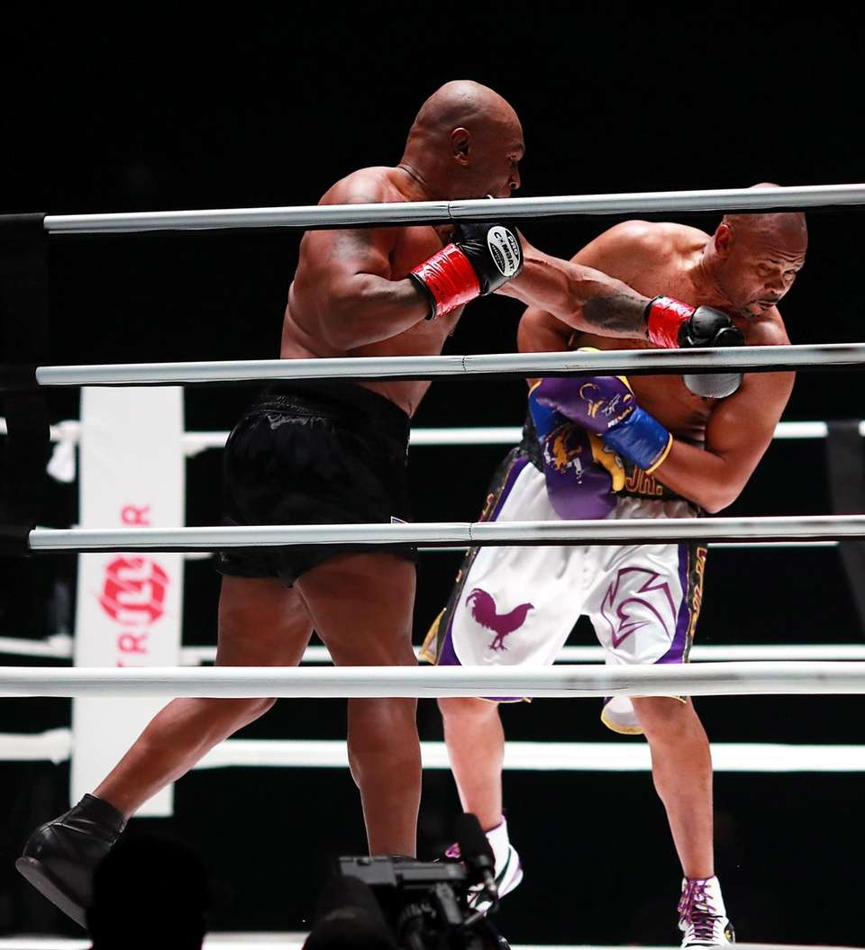 Mike Tyson throws a punch in the third