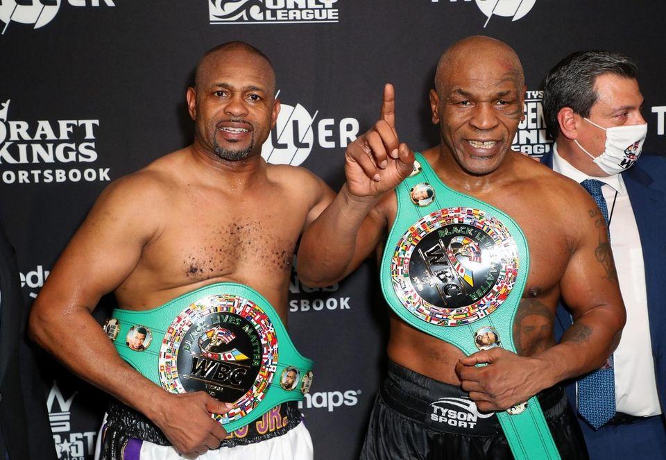 Roy Jones Jr. (L) and Mike Tyson celebrate