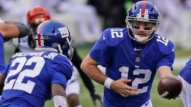 New York Giants quarterback Colt McCoy hands off