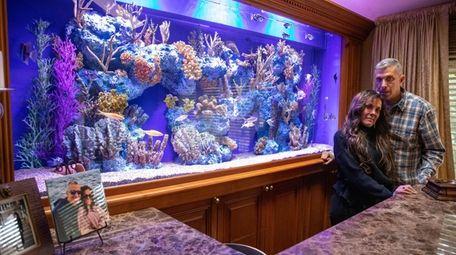 David and Daryl Schiffman by their 40-gallon aquarium
