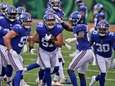 Giants defensive end Niko Lalos (57) celebrates an