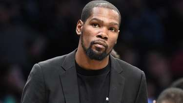 Brooklyn Nets' Kevin Durant looks on during a
