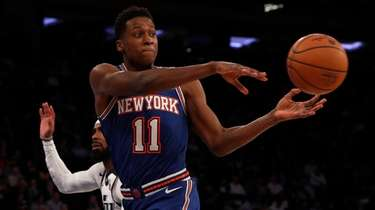 Frank Ntilikina of the New York Knicks dishes