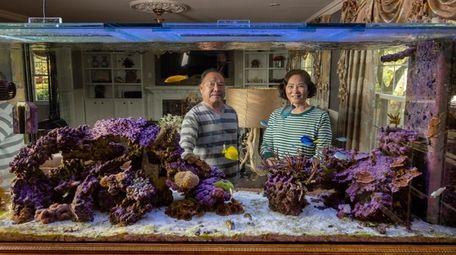 Kenneth Wang's parents, Faji Liu, left, and Cunyangpeng