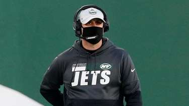 Adam Gase of the Jets looks on in