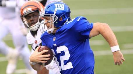 Colt McCoy #12 of the Giants carries the